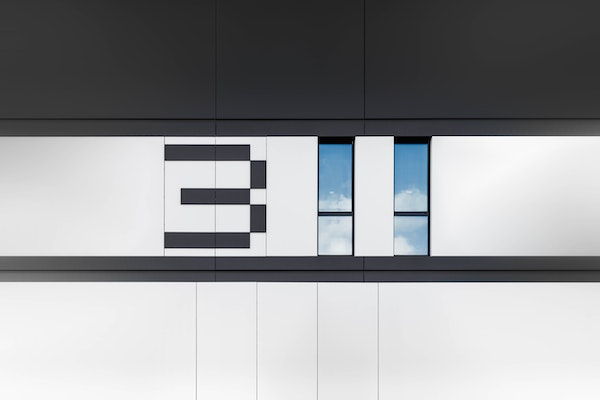 Image of building with windows that look like they spell out 311.